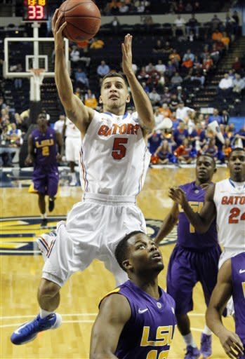Florida guard Scottie Wilbekin (5) shoots as LSU guard Andre Stringer, bottom, looks on during the first half of an NCAA college basketball game at the Southeastern Conference tournament, Friday, March 15, 2013, in Nashville, Tenn. (AP Photo/John Bazemore)