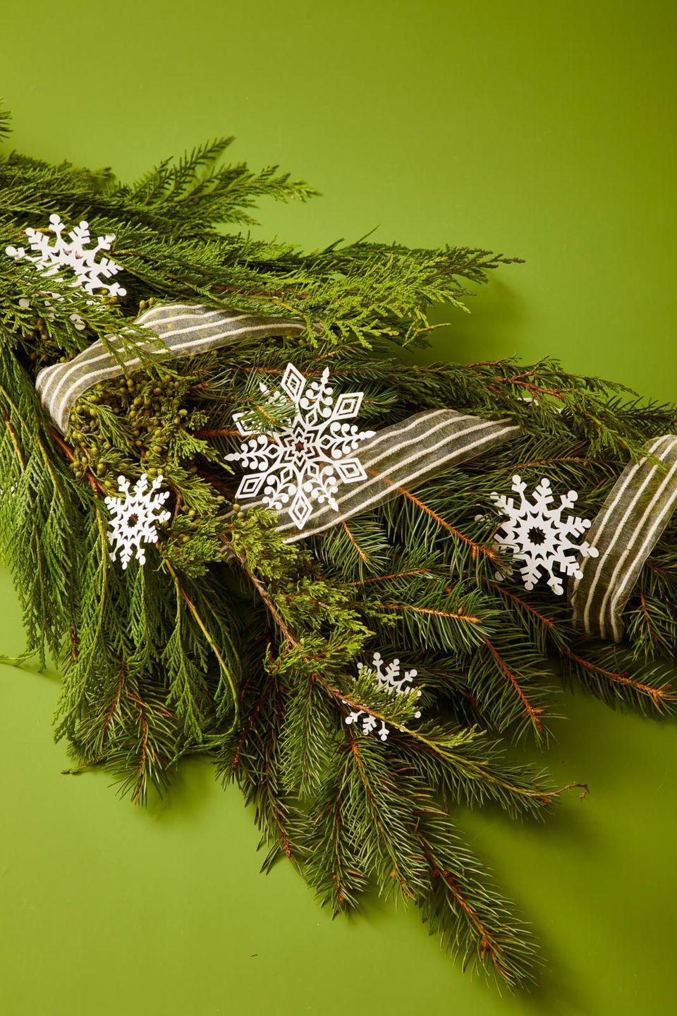 """<p>And if you have any more Cricut patience leftover, use the snowflake template to cut out snowflake-shaped ornaments, which also look nice as gift-toppers. </p><p><strong>RELATED: </strong><a href=""""https://www.goodhousekeeping.com/holidays/christmas-ideas/g4080/clever-diy-christmas-cards/"""" rel=""""nofollow noopener"""" target=""""_blank"""" data-ylk=""""slk:The Best DIY Christmas Cards for the Most Meaningful Holiday Notes Ever"""" class=""""link rapid-noclick-resp"""">The Best DIY Christmas Cards for the Most Meaningful Holiday Notes Ever</a></p>"""