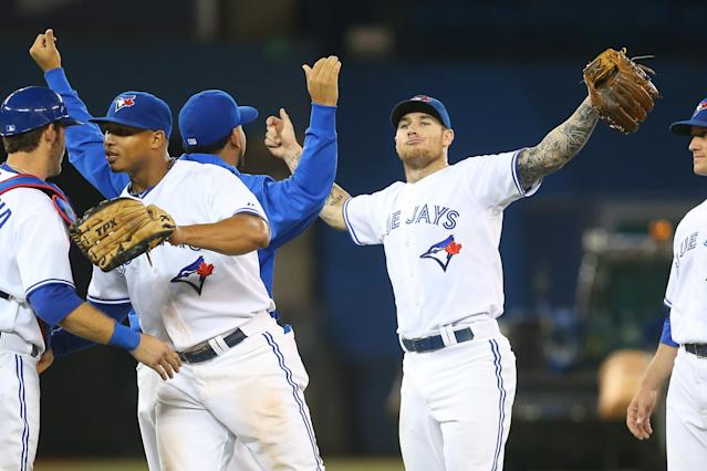 TORONTO, CANADA - OCTOBER 3: Brett Lawrie #17 of the Toronto Blue Jays celebrates with teammates after defeating the Minnesota Twins in MLB game action on October 3, 2012 at Rogers Centre in Toronto, Ontario, Canada. (Photo by Tom Szczerbowski/Getty Images)