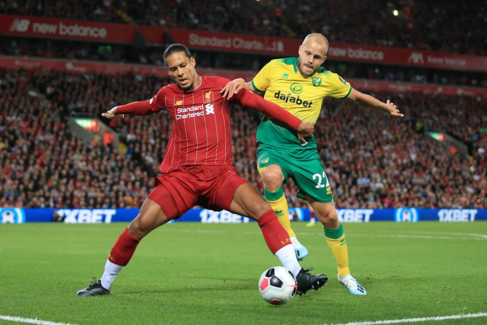 LIVERPOOL, ENGLAND - AUGUST 09: Virgil van Dijk of Liverpool battles with Teemu Pukki of Norwich during the Premier League match between Liverpool and Norwich City at Anfield on August 9, 2019 in Liverpool, United Kingdom. (Photo by Simon Stacpoole/Offside/Offside via Getty Images)