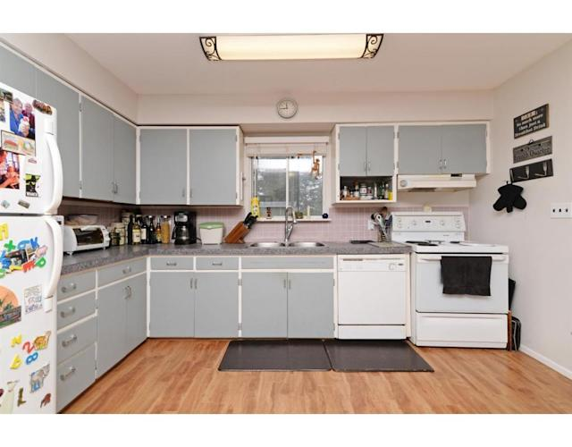 <p><span>324 Blue Mountain St., Coquitlam, B.C.<br></span>The large kitchen comes with all appliances.<br> (Photo: Zoocasa) </p>