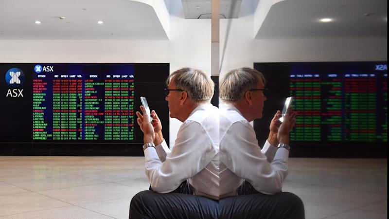 <p>The Australian share market is sharply lower at lunchtime, after Wall St was hammered.</p>