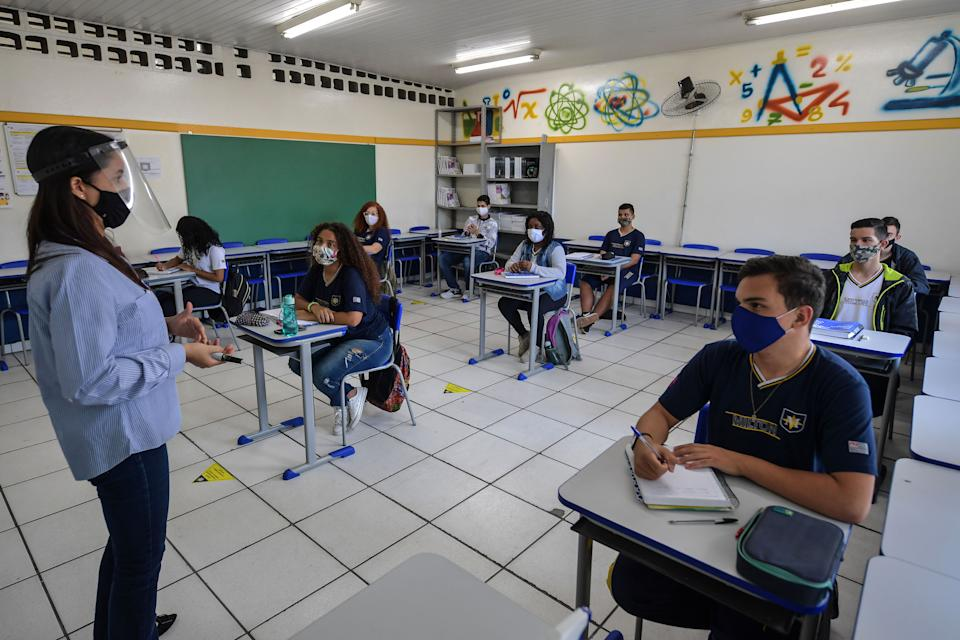 Students attend a class at Milton da Silva Rodrigues school, amid the novel coronavirus COVID-19 pandemic, in Sao Paulo, Brazil, on November 3, 2020, on the first day of return to high school students' classes in the state of Sao Paulo. (Photo by NELSON ALMEIDA / AFP) (Photo by NELSON ALMEIDA/AFP via Getty Images)