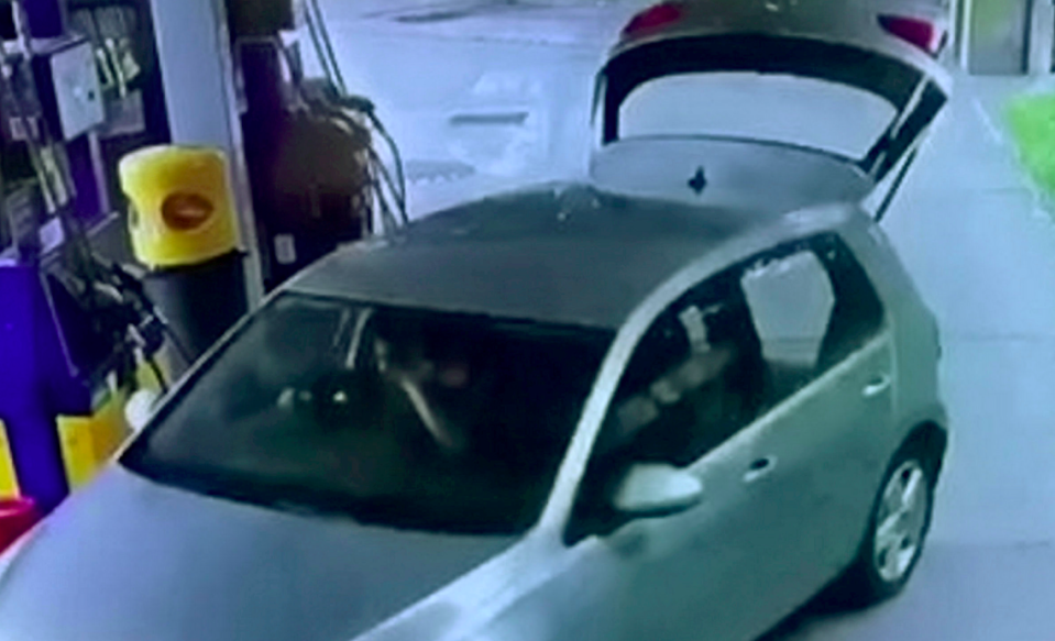 The thief sped away despite the boot of the car being wide open. (SWNS)