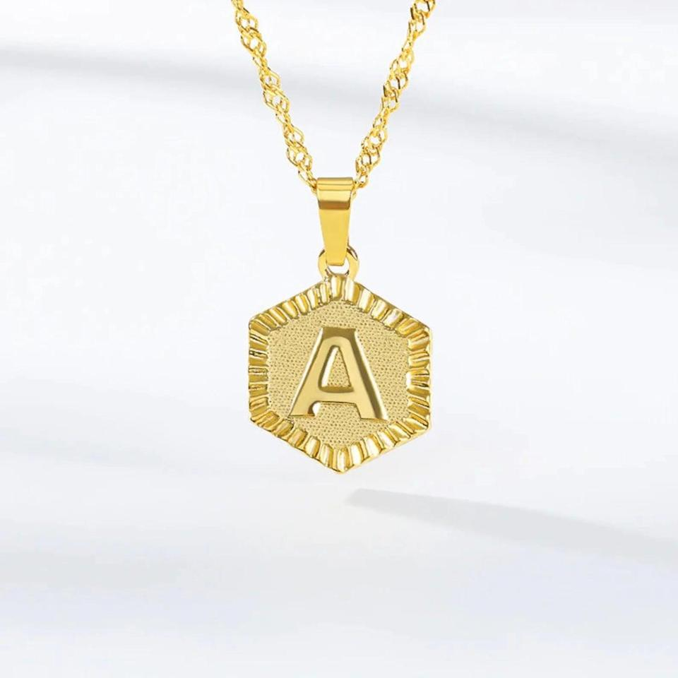 <p>They can stack and layer their dainty necklaces with this gorgeous <span>Hexagon Initial Pendant Necklace</span> ($18). It's a cute, personalized moment that is trendy.</p>