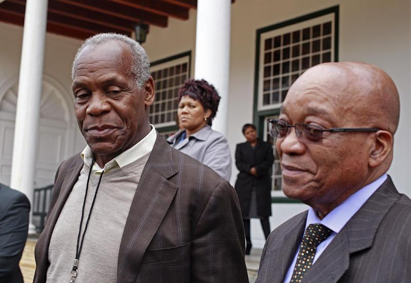 American actor and activist Danny Glover, left, interact with South African President Jacob Zuma, right, after a meeting in Cape Town, South Africa, Wednesday, May 29, 2013. Danny Glover made a courtesy call to South African President Jacob Zuma as part of his visit to South Africa as a delegation member of the United Automobile Workers Union of America. (AP Photo/Schalk van Zuydam)