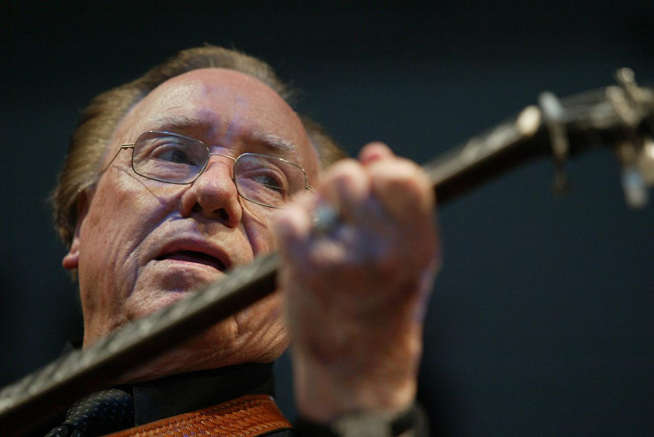 FILE - In this June 10, 2005 file photo, Earl Scruggs, performs at the Bonnaroo Music & Arts Festival in Manchester, Tenn. Scruggs' son Gary said his father passed away Wednesday morning, March 28, 2012 at a Nashville, Tenn., hospital of natural causes. He was 88. (AP Photo/Eric Parsons, File)