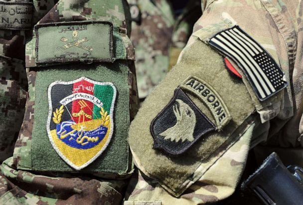 PHOTO: This picture taken on April 11, 2013, shows the badges of a U.S. soldier and a soldier of the Afghan National Army during a training session of ANA soldiers at the U.S. Shinwar Forward Base in the province of Nangarhar, Afghanistan. (Manjunath Kiran/AFP via Getty Images, FILE)
