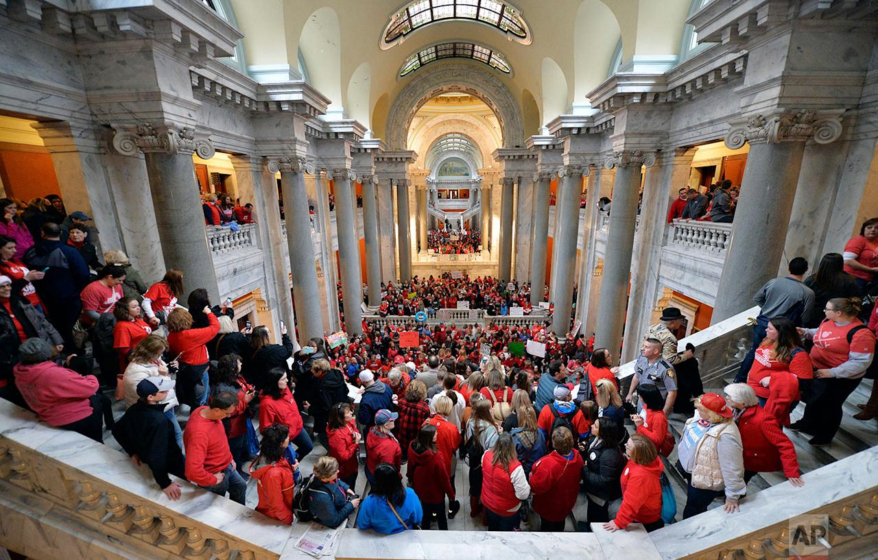<p>Teachers from across Kentucky fill the state Capitol to rally for increased funding and to protest changes to their state funded pension system in Frankfort, Ky. (AP Photo/Timothy D. Easley) </p>