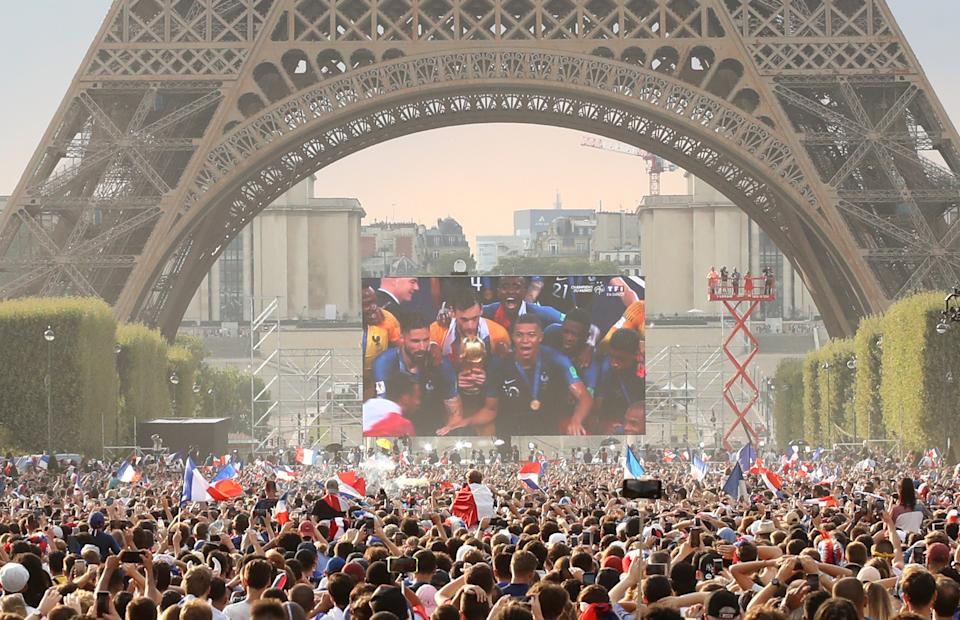 Thousands of people gather on the fan zone under the Eiffel Tower in Paris to watch their national side win the 2018 World Cup final against Croatia.