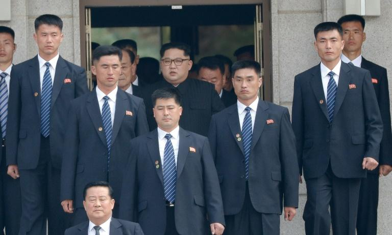 Is that a gun in your pocket? North Korean leader Kim Jong Un is always surrounded by tight security, and his bodyguards are chosen for their fitness, marksmanship and martial arts skills