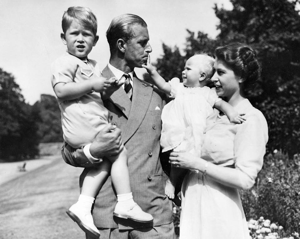 The then-Princess Elizabeth in the garden of Clarence House with Philip and their children Prince Charles and Princess Anne in 1951.Keystone Press Agency/Shutterstock