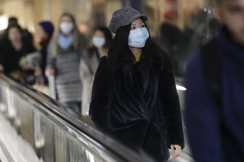 People wearing sanitary masks walk at the Centrale main railway station in Milan, Italy, Monday, Feb. 24, 2020. Italy has been scrambling to check the spread of Europe's first major outbreak of the new viral disease amid rapidly rising numbers of infections and a third death, calling off the popular Venice Carnival, scrapping major league soccer matches in the stricken area and shuttering theaters, including Milan's legendary La Scala. (AP Photo/Luca Bruno)