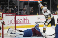 Vegas Golden Knights center Jonathan Marchessault, right, reacts after soring a goal past Colorado Avalanche goaltender Philipp Grubauer during the third period of Game 5 of an NHL hockey Stanley Cup second-round playoff series Tuesday, June 8, 2021, in Denver. (AP Photo/David Zalubowski)