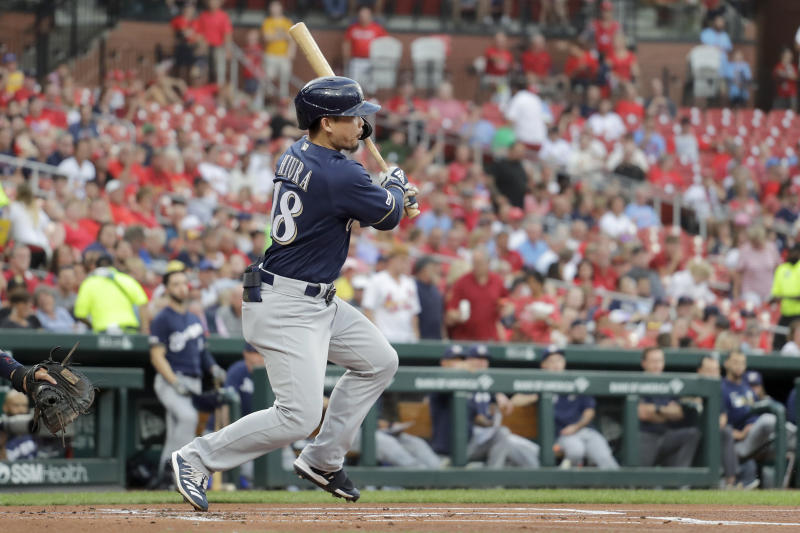 Milwaukee Brewers' Keston Hiura follows through on an RBI single during the first inning of a baseball game against the St. Louis Cardinals Wednesday, Aug. 21, 2019, in St. Louis. (AP Photo/Jeff Roberson)