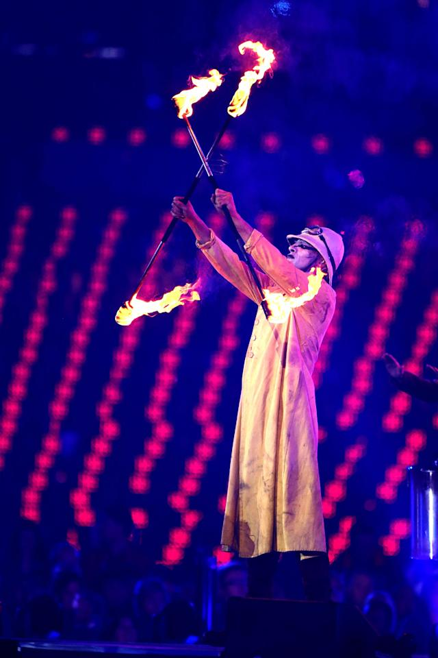 LONDON, ENGLAND - SEPTEMBER 09: A performer displays flaming torches during the closing ceremony on day 11 of the London 2012 Paralympic Games at Olympic Stadium on September 9, 2012 in London, England. (Photo by Peter Macdiarmid/Getty Images)