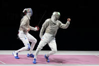 Aron Szilagyi of Hungary, right, celebrates winning the gold medal after defeating Luigi Samele of Italy compete in the men's individual final Sabre competition at the 2020 Summer Olympics, Saturday, July 24, 2021, in Chiba, Japan. (AP Photo/Hassan Ammar)