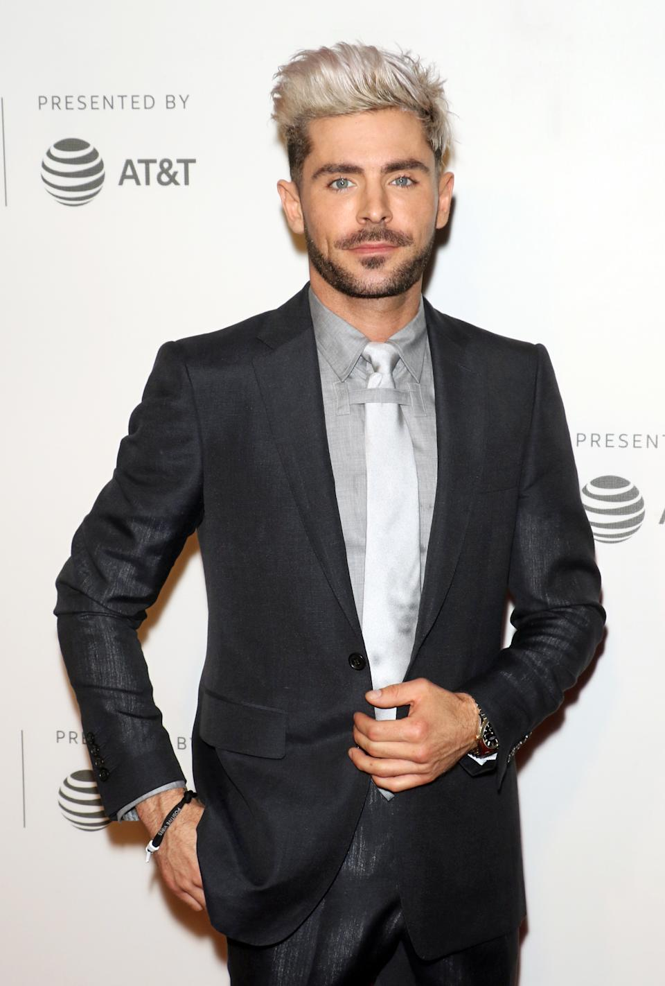 Zac's normal look is quite the opposite to his character in Gold. Photo: Getty