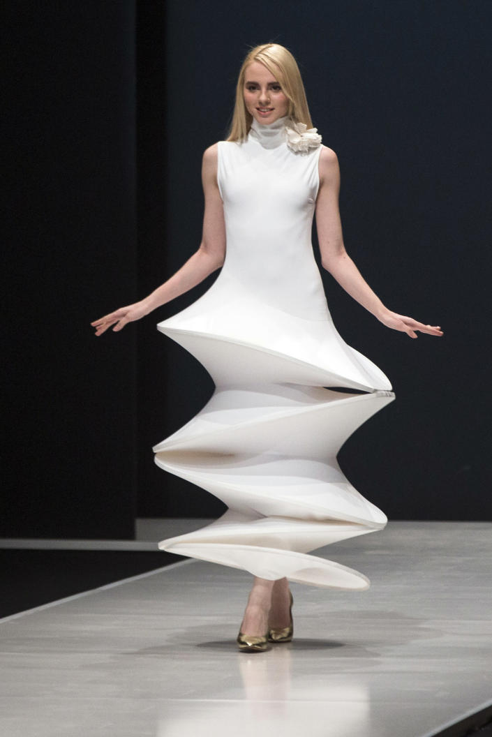 FILE - In this March 22, 2016 file photo, a model displays a creation by French fashion designer Pierre Cardin during Moscow Fashion Week, Russia. Pierre Cardin, the French designer whose famous name embossed myriad consumer products after his iconic Space Age styles shot him into the fashion stratosphere in the 1960s, has died, the French Academy of Fine Arts said Tuesday. He was 98. (AP Photo/Pavel Golovkin, File)