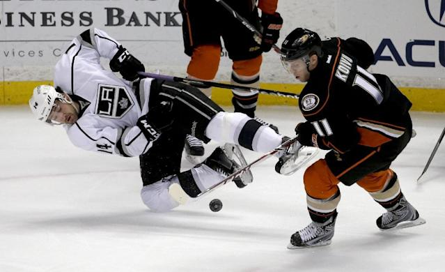 Anaheim Ducks center Saku Koivu, right, steals the puck away from Los Angeles Kings right wing Justin Williams during the first period of an NHL hockey game in Anaheim, Calif., Thursday, Jan. 23, 2014. (AP Photo/Chris Carlson)