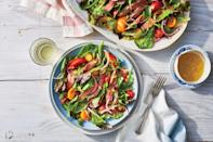 """<p><strong>Recipe: </strong><a href=""""https://www.southernliving.com/recipes/grilled-steak-salad-green-tomato-vinaigrett-recipe"""" rel=""""nofollow noopener"""" target=""""_blank"""" data-ylk=""""slk:Grilled Steak Salad with Green Tomato Vinaigrette"""" class=""""link rapid-noclick-resp""""><strong>Grilled Steak Salad with Green Tomato Vinaigrette</strong></a></p> <p>When it's too hot for the oven, take it outside and light the grill for a fresh but filling summer salad.</p>"""