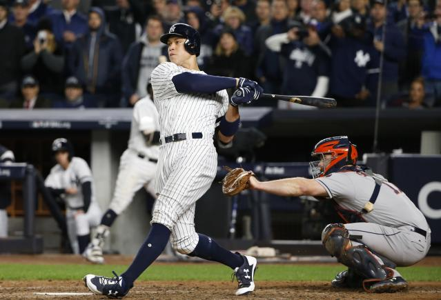 New York Yankees' Aaron Judge hits a three-run home run during the fourth inning of Game 3 of baseball's American League Championship Series against the Houston Astros Monday, Oct. 16, 2017, in New York. (AP)