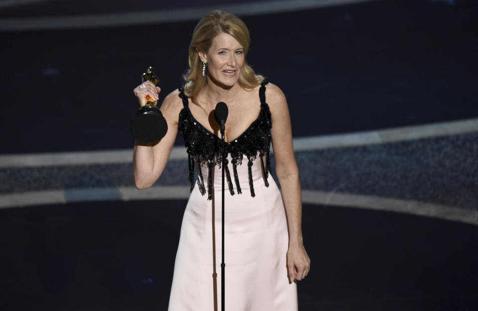 """Laura Dern accepts the award for best performance by an actress in a supporting role for """"Marriage Story"""" at the Oscars on Sunday, Feb. 9, 2020. (AP Photo/Chris Pizzello)"""