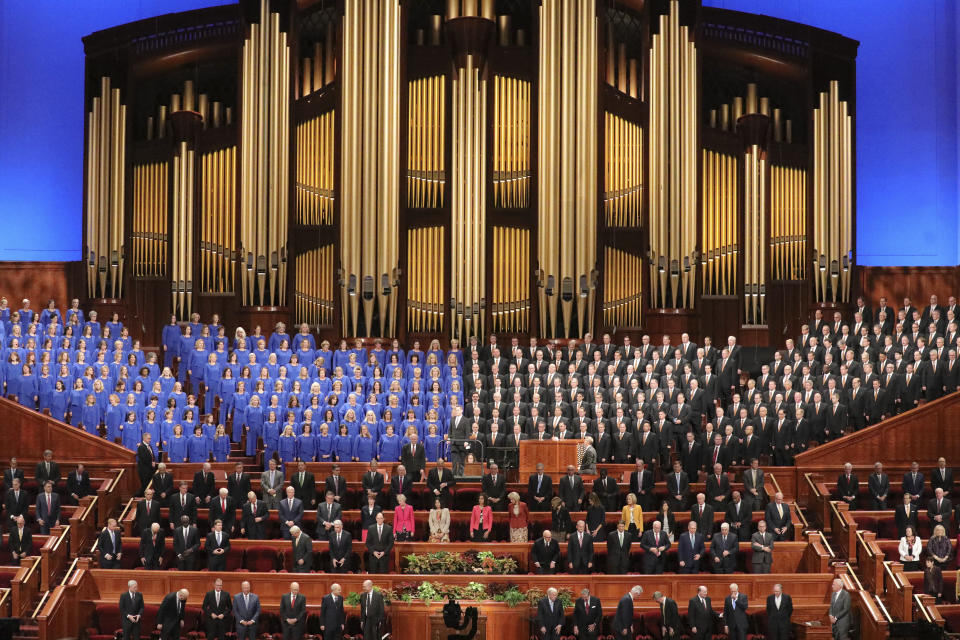 FILE - In this Oct. 5, 2019 file photo, the Tabernacle Choir at Temple Square perform during The Church of Jesus Christ of Latter-day Saints' twice-annual church conference in Salt Lake City. For the third consecutive time, The Church of Jesus Christ of Latter-day Saints will hold its signature conference this weekend without attendees in person as the faith continues to take precautions amid the pandemic. Members of the Utah-based faith will instead watch on TVs, computers and tablets from their homes around the world Saturday, April 3, 2021 to hear spiritual guidance from the religion's top leaders, who will be delivering the speeches in Salt Lake City. (AP Photo/Rick Bowmer, File)