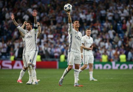 Real Madrid's Cristiano Ronaldo celebrates after the game with the match ball after scoring a hat trick