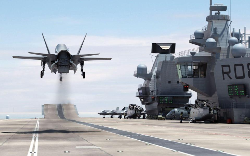 Ministry of Defence computer generated image showing a F-35B Lightning II jet landing vertically on the Royal Navy's new aircraft carrier HMS Queen Elizabeth - BAE Systems/PA