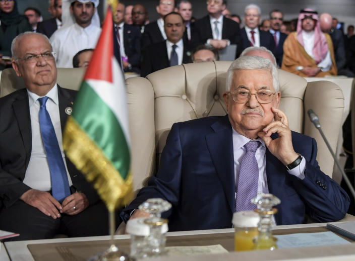 FILE - In this March 31, 2019 file photo, Palestinian President Mahmoud Abbas, right, and Secretary General of the Palestinian Liberation Organization Saeb Erekat, attend the 30th Arab Summit in Tunis, Tunisia. Erekat, a veteran peace negotiator and prominent international spokesman for the Palestinians for more than three decades, died Tuesday, Nov. 10, 2020. He was 65. (Fethi Belaid/ Pool photo via AP, FIle)