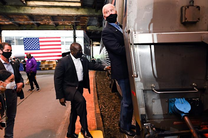 Supporters listen as Democratic presidential candidate Joe Biden boards his train at the Pittsburgh station on Wednesday.