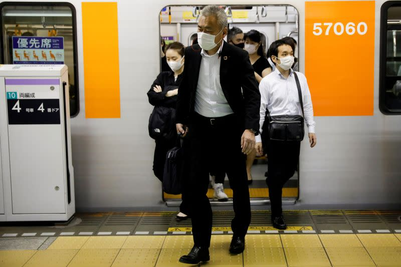FILE PHOTO: Passengers pictured at Shibuya subway station in Tokyo