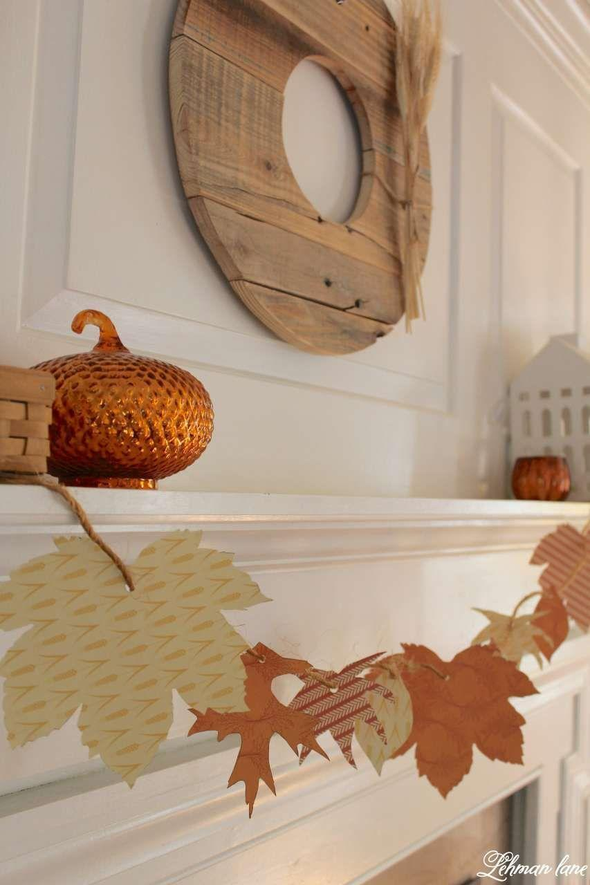 """<p>The kiddos will love making this card stock leaf garland with you. Use any fall pattern you please and cut them out using real leaves as templates. </p><p><strong>Get the tutorial at <a href=""""http://lehmanlane.net/diy-simple-fall-garland-fall-mantel/"""" rel=""""nofollow noopener"""" target=""""_blank"""" data-ylk=""""slk:Lehman Lane"""" class=""""link rapid-noclick-resp"""">Lehman Lane</a>.</strong></p><p><a class=""""link rapid-noclick-resp"""" href=""""https://go.redirectingat.com?id=74968X1596630&url=https%3A%2F%2Fwww.walmart.com%2Fip%2FWestcott-All-Purpose-Scissors-8-Stainless-Steel-Bent-Pink-Black-for-Office-1-Count%2F869778181&sref=https%3A%2F%2Fwww.thepioneerwoman.com%2Fhome-lifestyle%2Fcrafts-diy%2Fg36891743%2Ffall-mantel-decorations%2F"""" rel=""""nofollow noopener"""" target=""""_blank"""" data-ylk=""""slk:SHOP SCISSORS"""">SHOP SCISSORS</a></p>"""