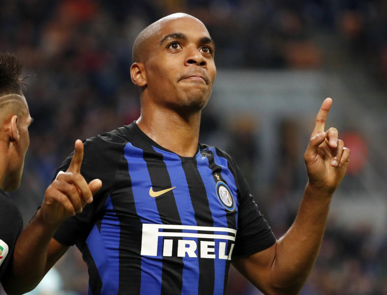 FILE - In this Saturday, Nov. 3, 2018 file photo, Inter Milan's Joao Mario celebrates after scoring his team's fourth goal during the Serie A soccer match between Inter Milan and Genoa at the San Siro Stadium in Milan, Italy. Portugal midfielder Joao Mario says it is not safe to start playing again as the world is dealing with the coronavirus pandemic. The European Championship winner is currently on loan from Inter Milan at Russian club Lokomotiv Moscow. (AP Photo/Antonio Calanni, File)