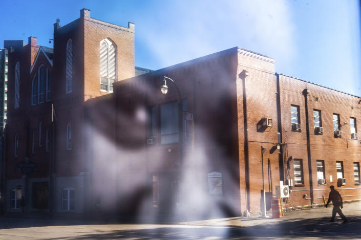 The Historic Ebenezer First Baptist Church is reflected in a photo of Martin Luther King Jr., Monday, Jan. 18, 2021, in Atlanta. (AP Photo/Branden Camp)