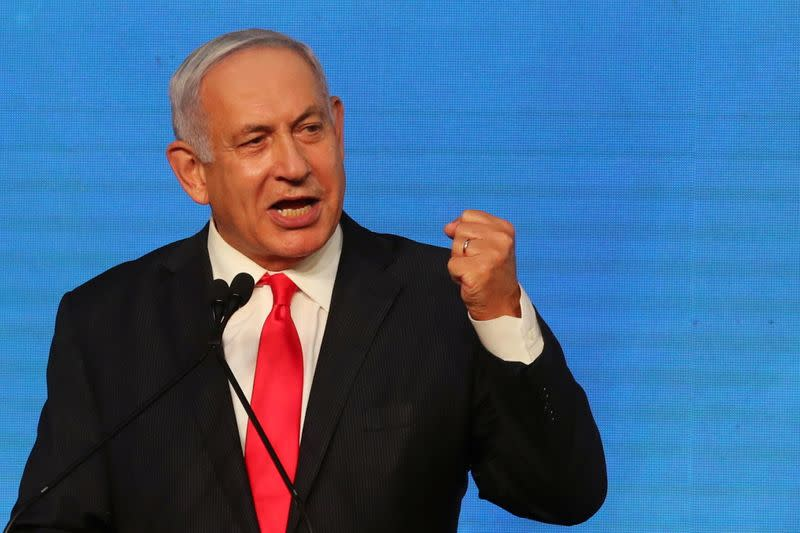 Israeli Prime Minister Benjamin Netanyahu gestures as he delivers a speech to supporters following the announcement of exit polls in Israel's general election at his Likud party headquarters in Jerusalem