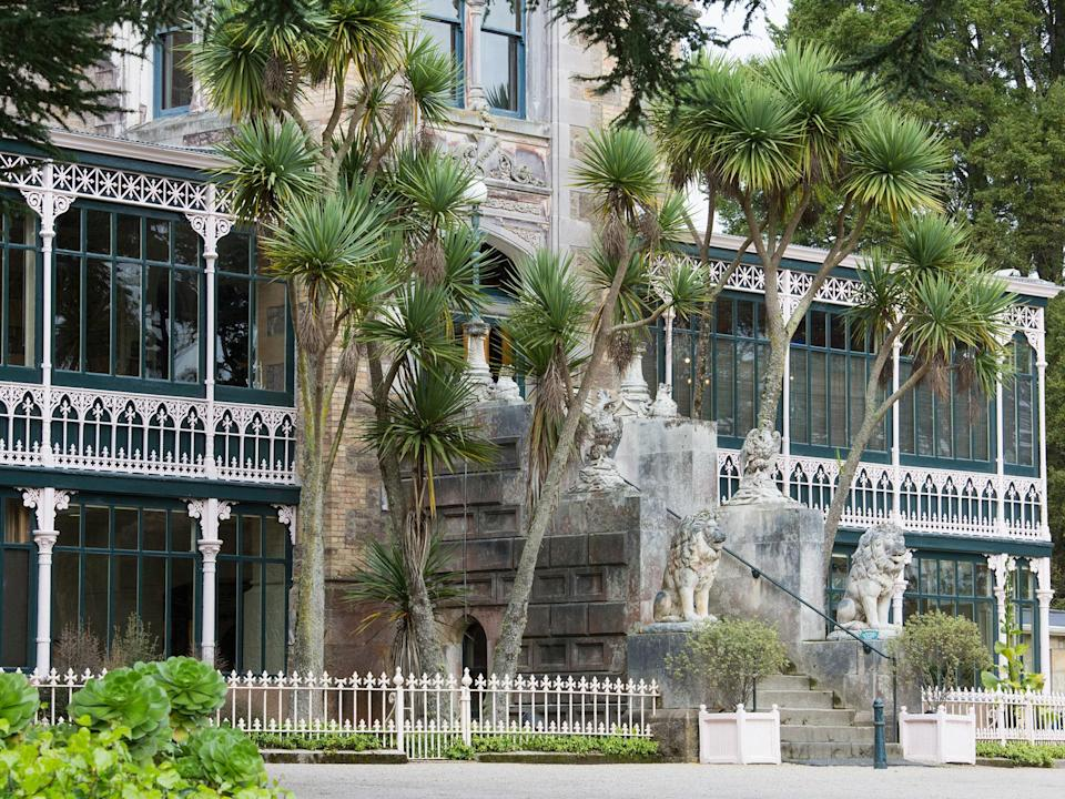 "Larnach was built between 1871 and 1887 to serve as the residence of William Larnach, a prominent local politician in <a href=""https://www.cntraveler.com/story/new-zealand-road-trip-auckland-to-wellington?mbid=synd_yahoo_rss"" rel=""nofollow noopener"" target=""_blank"" data-ylk=""slk:New Zealand"" class=""link rapid-noclick-resp"">New Zealand</a>. Most notable is a 3,000-square-foot ballroom, which Larnach had built as a 21st birthday present for his favorite daughter Kate, who later died of typhoid at age 26, and is said to still haunt the ballroom. Don't chalk those taps on your shoulder and whispers in your ear as all up to imagination, though: The building has been visited by paranormal investigators and featured on <em>Ghost Hunters International</em>."