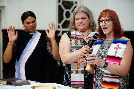 Trans pastors Cindy Bourgeois from Canada (C) and Alexya Salvador from Brazil listen to trans Baptist reverend Allyson Robinson from the U.S. during a mass in Matanzas, Cuba, May 5, 2017. Picture taken on May 5, 2017. REUTERS/Alexandre Meneghini