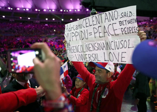 <p>A participant holds a sign during the closing ceremony at the 2016 Rio Olympics on August 21, 2016. (REUTERS/Stefan Wermuth) </p>