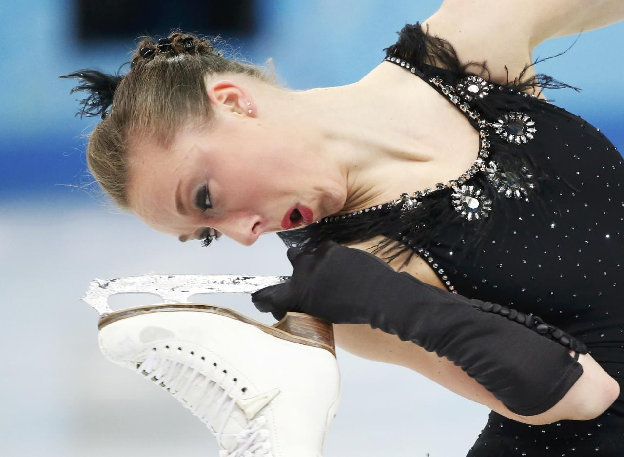Nathalie Weinzierl of Germany competes during the Team Ladies Short Program at the Sochi 2014 Winter Olympics, February 8, 2014. REUTERS/Lucy Nicholson (RUSSIA - Tags: SPORT FIGURE SKATING SPORT OLYMPICS)