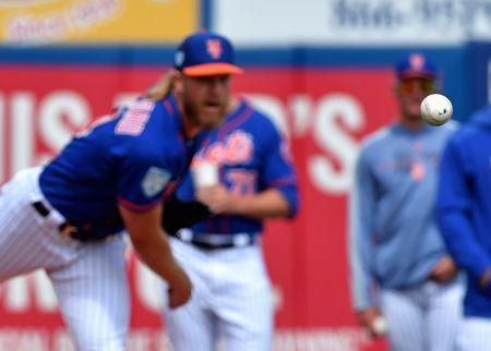 Mar 13, 2019; Port St. Lucie, FL, USA; New York Mets starting pitcher Noah Syndergaard (34) warms up in the bullpen before a spring training game against the Houston Astros at First Data Field. Mandatory Credit: Steve Mitchell-USA TODAY Sports