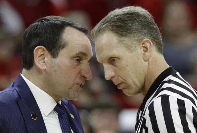 Duke coach Mike Krzyzewski, left, speaks with an official during the second half of an NCAA college basketball game against North Carolina State in Raleigh, N.C., Sunday, Jan. 11, 2015. North Carolina State won 87-75. (AP Photo/Gerry Broome)