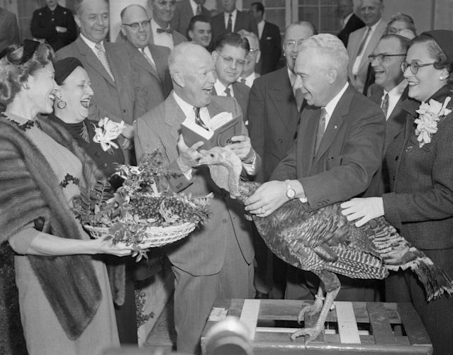 <p>President Eisenhower (left) seems highly pleased with the 43-pound Kentucky colonel turkey from the blue-grass state, presented to him at the White House by Peary Browning (right) of Winchester, Kentucky, president of the National Turkey Federation on Nov. 17, 1954. The Thanksgiving bird was selected from a flock of 100,000 at Browning's farm. (Photo: Bettmann/Corbis/Getty Images) </p>
