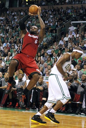 Miami Heat forward LeBron James (6) shoots over Boston Celtics guard Rajon Rondo, right, during the first half in Game 6 of the NBA basketball Eastern Conference finals, Thursday, June 7, 2012, in Boston. (AP Photo/The Miami Herald, Charles Trainor Jr.) MAGS OUT