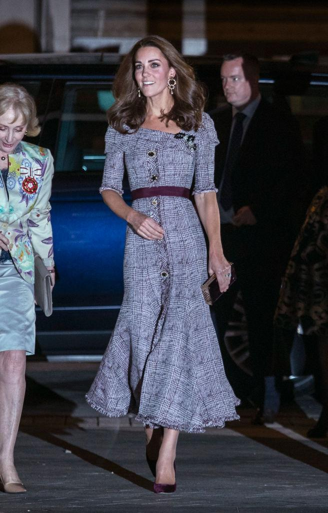 <p>On October 10, the Duchess of Cambridge wore an off-the-shoulder £1,395 dress by Erdem to open the Victoria and Albert Museum's new photography centre. She finished the ensemble with Erdem earrings and a pair of velvet heels by Jimmy Choo. <em>[Photo: Getty]</em> </p>