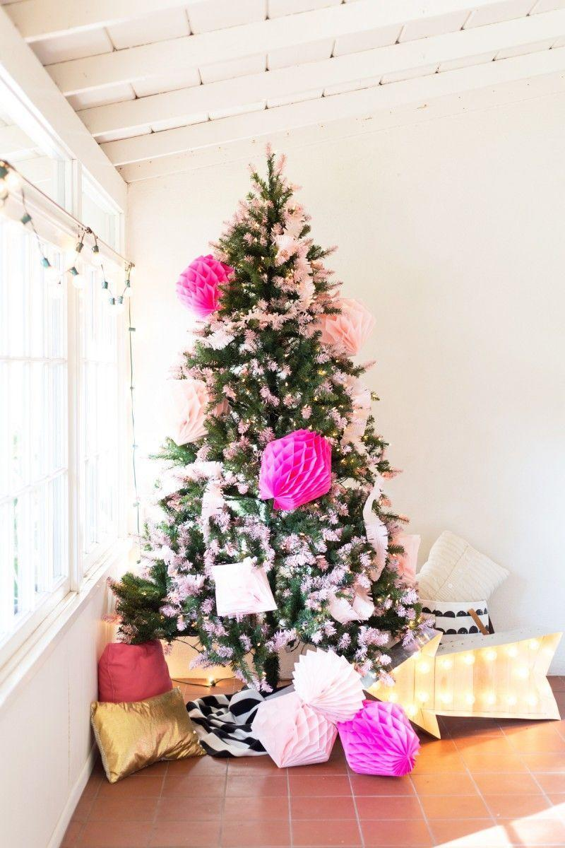 """<p>If you've got a passion for pink, then this girly pink tipped tree is probably calling your name. </p><p><strong><em>Get the tutorial at <a href=""""https://lovelyindeed.com/diy-pink-tipped-honeycomb-christmas-tree/"""" rel=""""nofollow noopener"""" target=""""_blank"""" data-ylk=""""slk:Lovely Indeed"""" class=""""link rapid-noclick-resp"""">Lovely Indeed</a>. </em></strong></p><p><a class=""""link rapid-noclick-resp"""" href=""""https://www.amazon.com/Honeycomb-Backdrop-Decoration-Wedding-Birthday/dp/B083R72T8T?tag=syn-yahoo-20&ascsubtag=%5Bartid%7C10070.g.2025%5Bsrc%7Cyahoo-us"""" rel=""""nofollow noopener"""" target=""""_blank"""" data-ylk=""""slk:SHOP PINK HONEYCOMBS"""">SHOP PINK HONEYCOMBS</a></p>"""