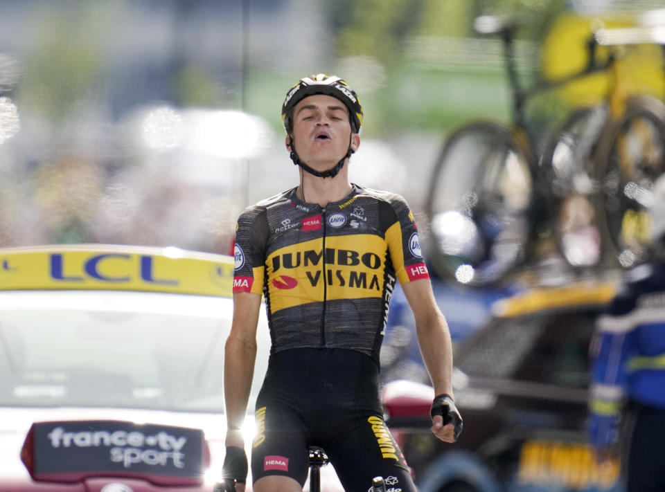 Sepp Kuss of the US celebrates as he crosses the finish line to win the fifteenth stage of the Tour de France cycling race over 191.3 kilometers (118.9 miles) with start in Ceret, France, and finish in Andorra-la-Vella, Andorra, Sunday, July 11, 2021. (AP Photo/Christophe Ena)
