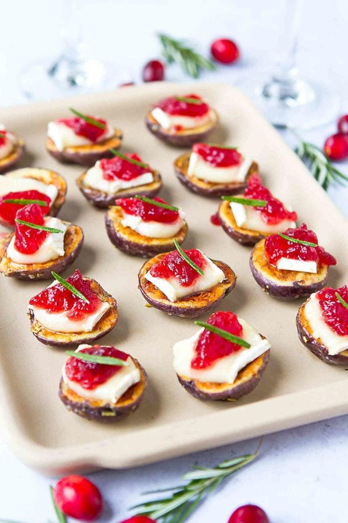 """<p>When you make this recipe, you'll get to enjoy warm brie cheese atop roasted potatoes that are doused in a dollop of cranberry sauce. They're seasonal, festive, and too tasty to pass up.</p> <p><strong>Get the recipe</strong>: <a href=""""https://www.cookincanuck.com/brie-cranberry-potato-bites-recipe/"""" class=""""link rapid-noclick-resp"""" rel=""""nofollow noopener"""" target=""""_blank"""" data-ylk=""""slk:brie and cranberry potato bites"""">brie and cranberry potato bites</a> </p>"""