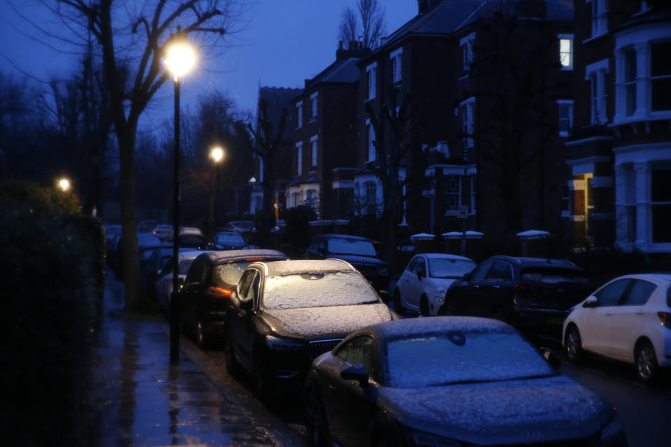 LONDON, ENGLAND - JANUARY 16: Cars have a light covering of snow early morning in Hampstead on January 15, 2021 in London, England. The Met Office issued an amber snow alert for the east of England and a yellow snow warning for the South East. (Photo by Hollie Adams/Getty Images)